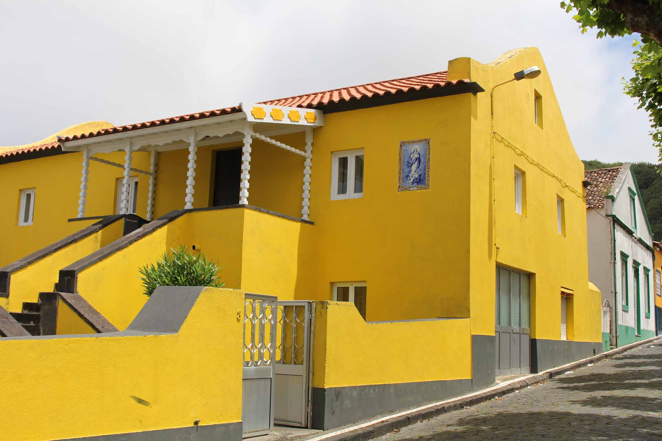 A typical yellow house in Mosteiros, São Miguel island, Azores
