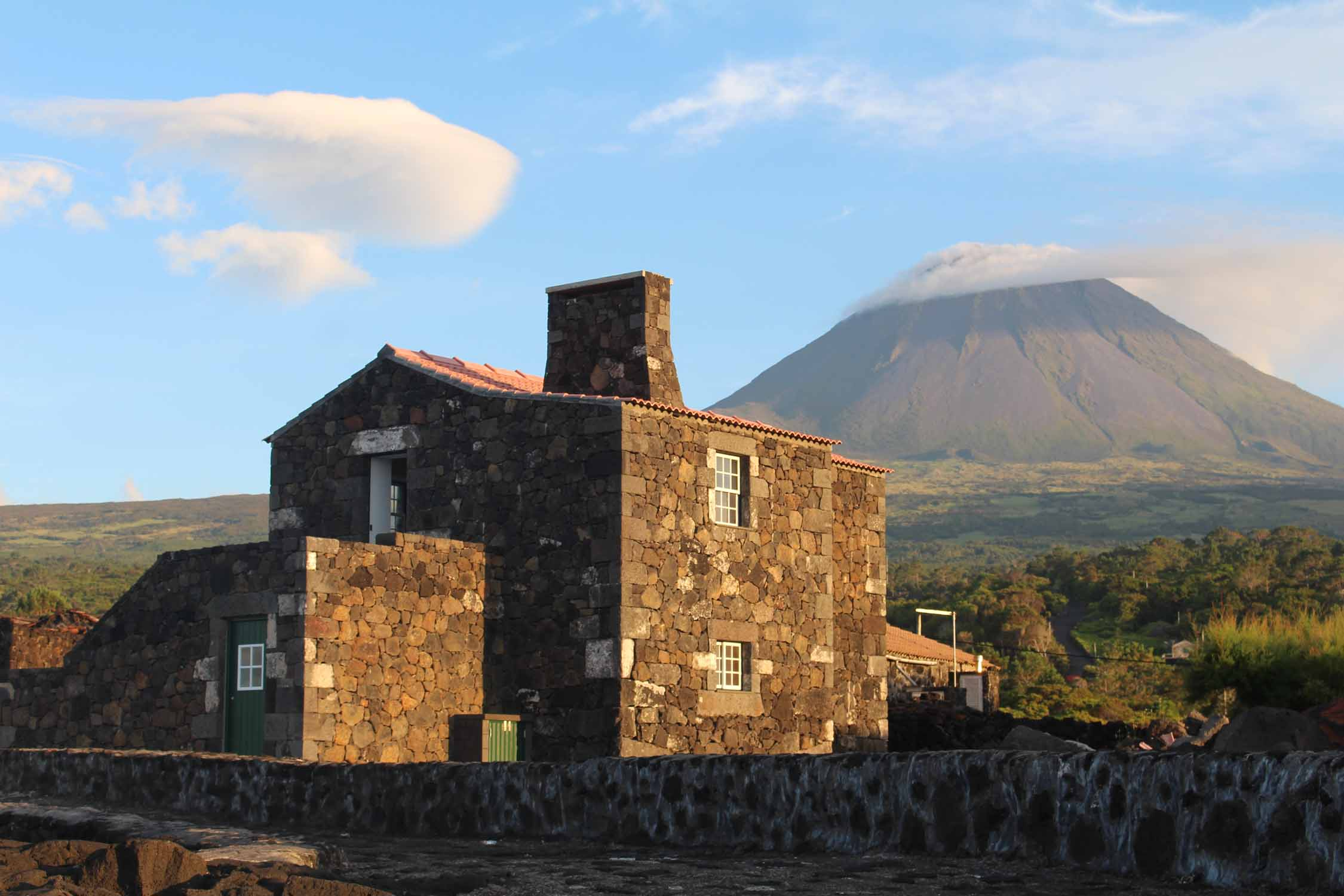 Typical house and the volcano of Pico, Azores