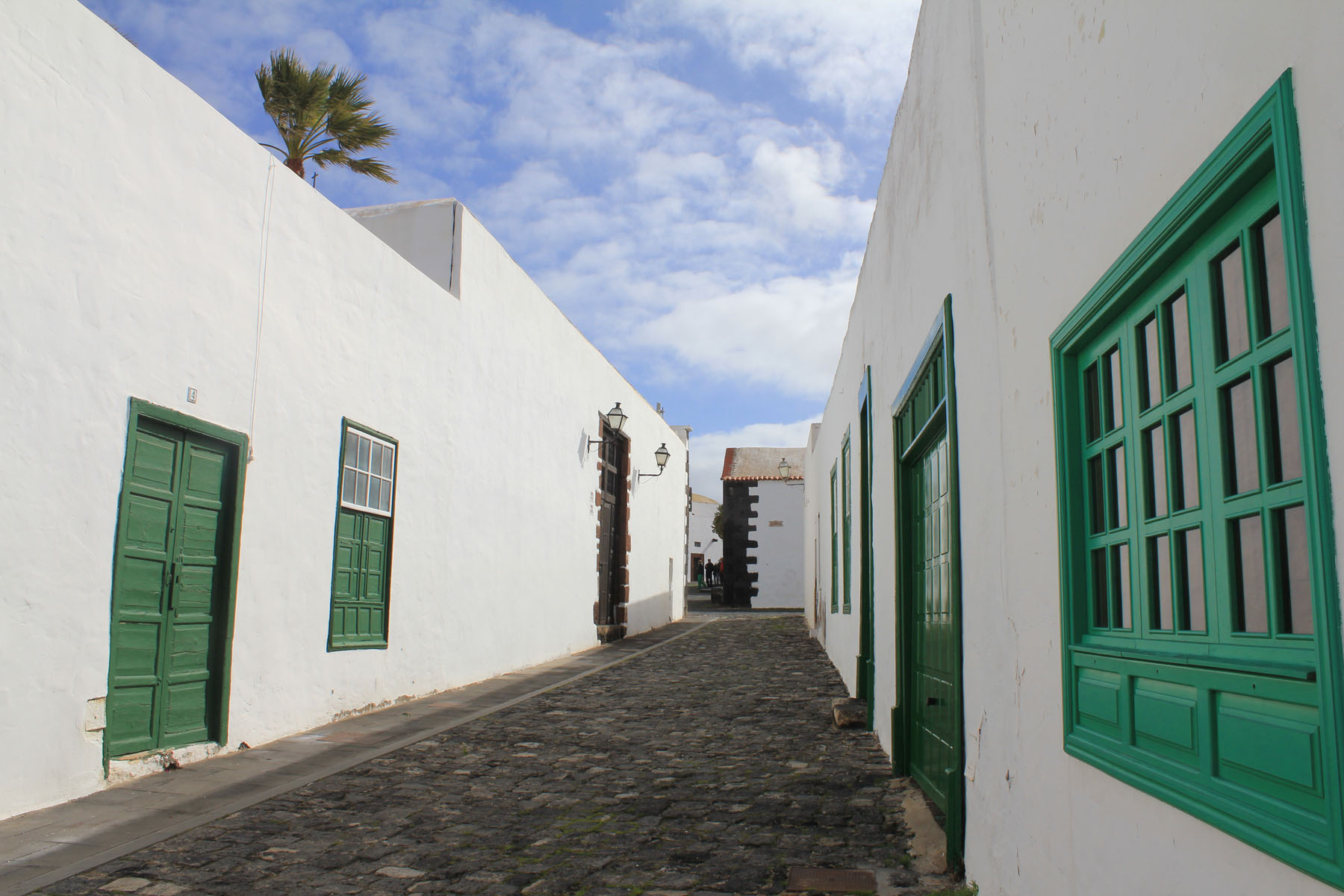 Teguise, white and green street