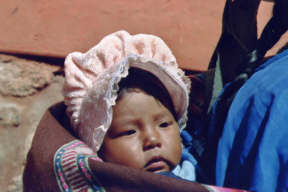 Potosi,  a baby in the back of her mother