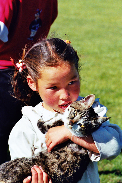 Young mongol girl, cat